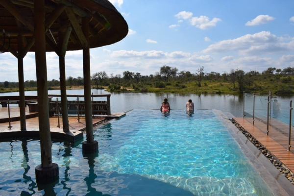 Watch the hippos from the pool at Xidulu