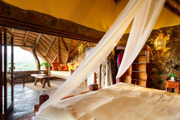 Canopy Beds in thatched room