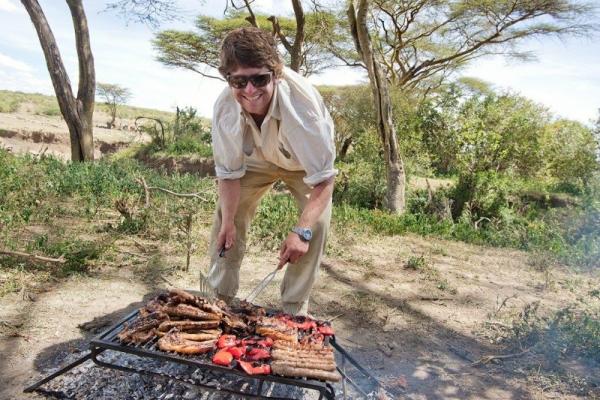 smiling man braaiing in Kenya