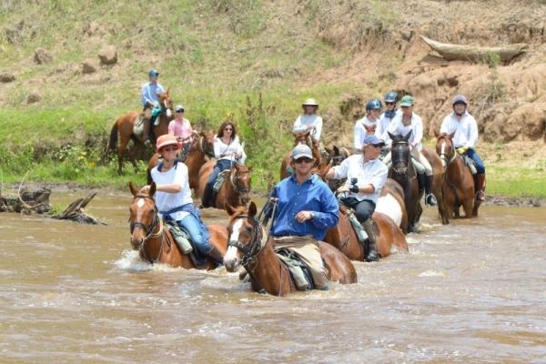 river crossing on horseback in the Masai Mara
