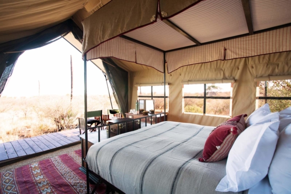 Explorer style canopy bed in luxury safari tent