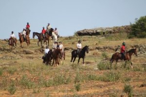 Horse riders on rocky Ugandan hillside