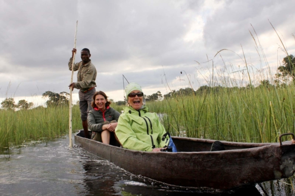 Smiling women in Mokoro canoe