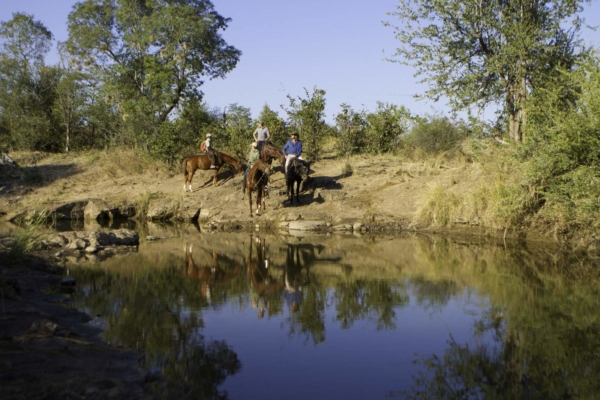 Horse riders and river