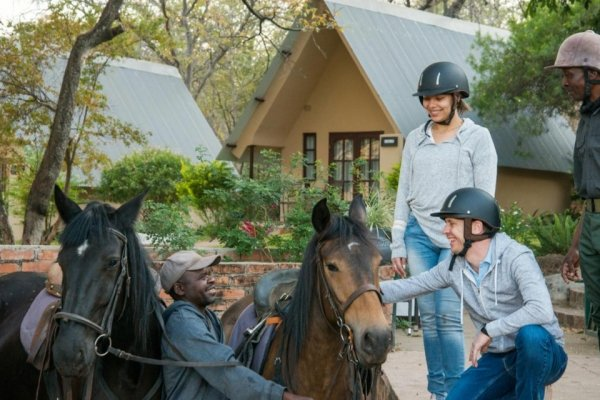 Horse riders getting ready to mount up