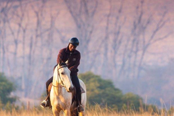 Swazi man on white horse