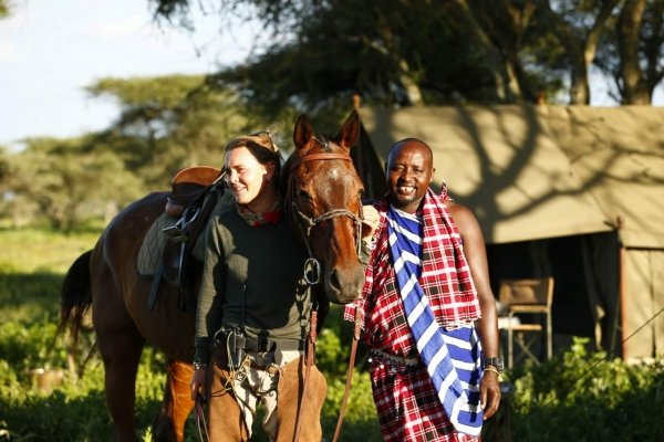 Woman and Masai warrior with horse
