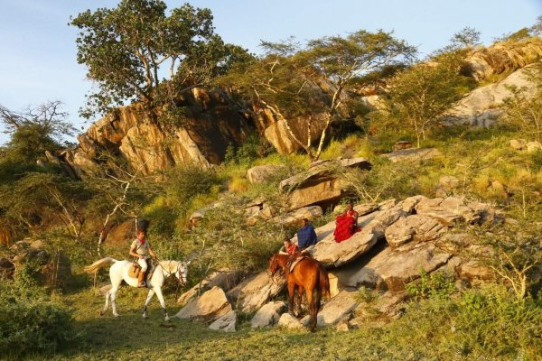 Horses and Masai in Serengeti
