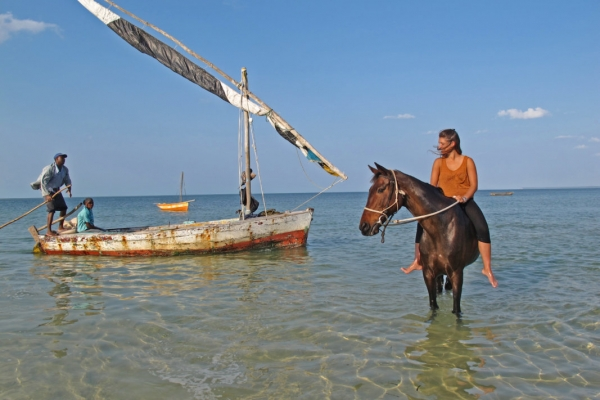 Girl riding bareback with dhow in Mozambique
