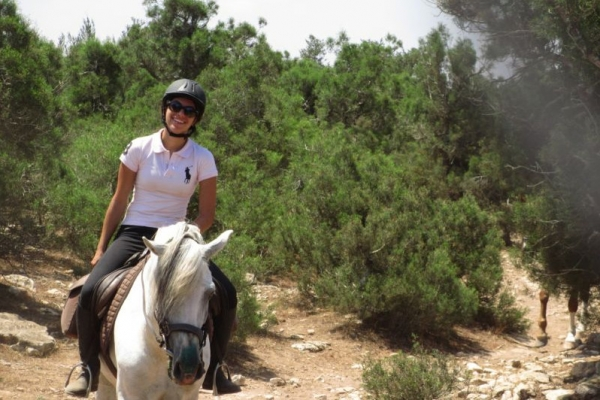 Smiling girl horse riding in Morrocco