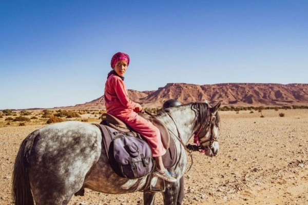 Moroccan man on horse in desert