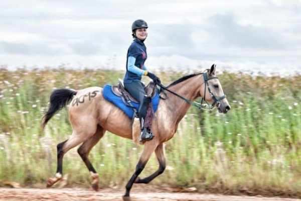 Girl on dun endurance horse